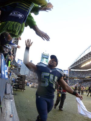 Seattle Seahawks middle linebacker Bobby Wagner (54) celebrates with fans following their victory over the Green Bay Packers in the NFC Championship Game at CenturyLink Field. The Seahawks defeated the Packers 28-22 in overtime.