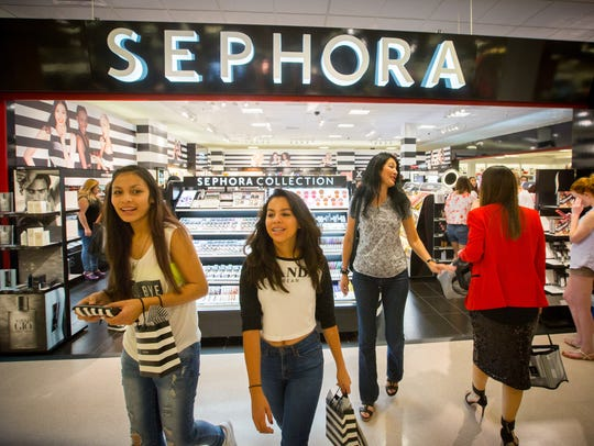 People pack the new Sephora boutique at JCPenney on
