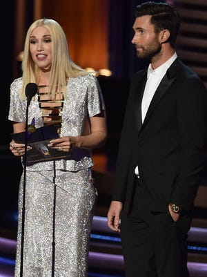 Gwen Stefani and Adam Levine speak onstage at the 66th Annual Primetime Emmy Awards held at Nokia Theatre L.A. Live on August 25, 2014 in Los Angeles, California.