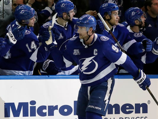 Tampa Bay Lightning center Steven Stamkos (91) celebrates with the bench after his goal against the Montreal Canadiens during the third period of an NHL hockey game Thursday, Dec. 28, 2017, in Tampa, Fla. (AP Photo/Chris O'Meara)