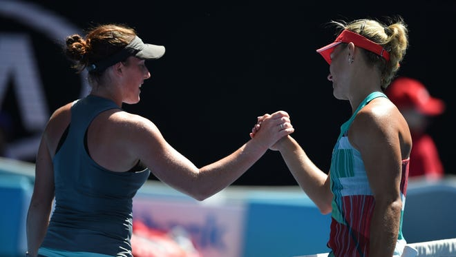 Madison Brengle (left) congratulates Angelique Kerber on her victory.
