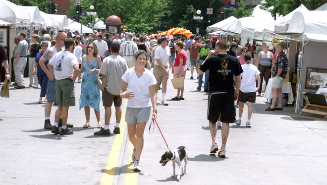 The Iowa Arts Festival is seen on Dubuque Street on Saturday, June 8, 2002 in this file photo. The Iowa City Downtown District is planning a block block party for June 24 that would include Dubuque and Washington streets as its main thoroughfares.