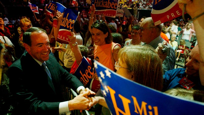 Arkansas Gov. Mike Huckabee shakes hands with the front row before he spoke at Iowa Straw Poll on Aug. 11, 2007 in Ames, Iowa.