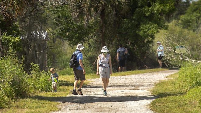 Visitors walk the trails at Circle B.