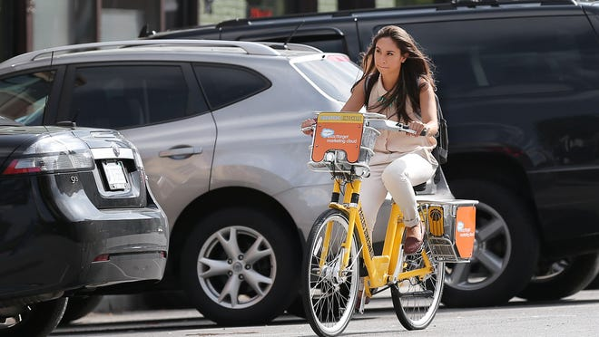 Camellia Beigh uses the Indiana Pacers Bikeshare program. Here she is cruising along Mass Ave.