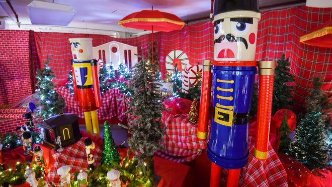 Larger-than-life nutcrackers, constructed from paint buckets, stand their posts at a section of the Christmas Dream exhibit at the Agana Shopping Center on Nov. 30, 2017.