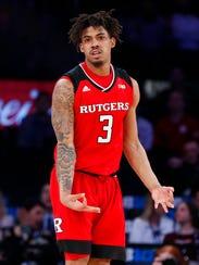 Rutgers guard Corey Sanders (3) gestures after scoring