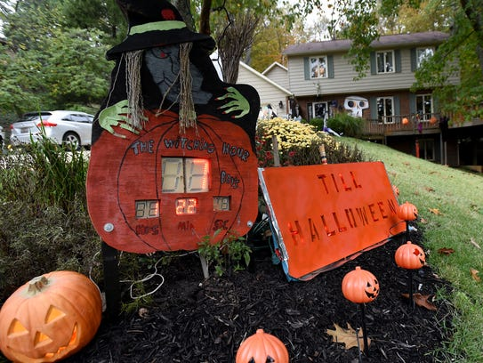 A clock counts down the days left to Halloween in the