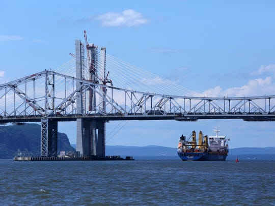 A ship travels north on the Hudson River under the