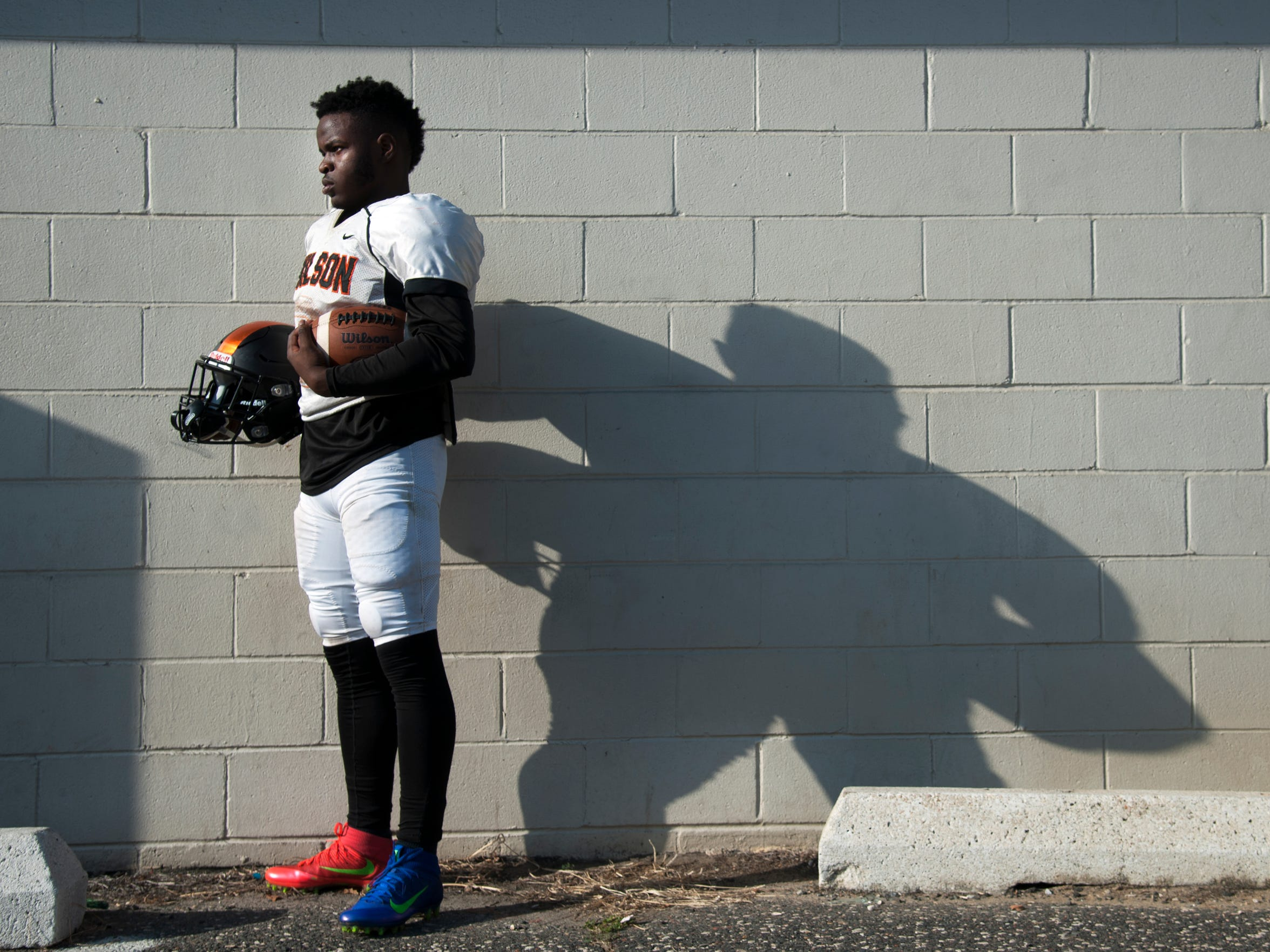 Woodrow Wilson senior running back, wide receiver, cornerback Hydir Moore stands for a portrait at Woodrow Wilson High School.  10.03.17
