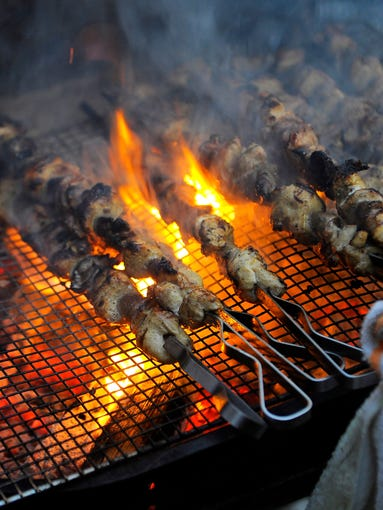 Fire licks skewers of chunks of chicken and goat as Charleston, S.C.-based chef BJ Dennis joins Husk chef Sean Brock to bring the cuisine of the Gullah culture to Nashville.