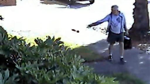 FILE - In this June 7, 2014 file image from from a security video provided by Philip Lao, shows Dennis Kneier, the mayor of San Marino, Calif., tosses a bag of dog waste onto the property of his Lao, in San Marino, Calif.   The Pasadena Star-News reports San Marino Mayor Dennis Kneier resigned Tuesday, June 17, 2014 after outcry from residents who say he smeared their image.