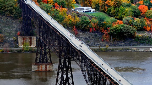 This aerial view of Walkway Over the Hudson State Park looks west toward Highland. The former railroad bridge connects the William R. Steinhaus Dutchess Rail Trail in Dutchess County with the Hudson Valley Rail Trail in the Town of Lloyd.