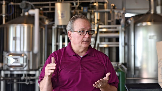 Owner Roy Dodds talks about plans for the new Urban Moose Brewing Co. during an interview Wednesday, June 15, 2016, in Sauk Rapids. The location will feature a brew pub with several food options, including Flying Pig Pizza.