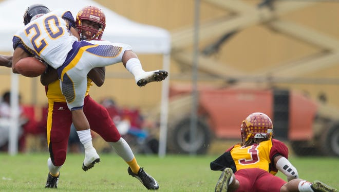Tuskegee defensive Jonah McCutcheon forces Miles running back Cartez Pickett to fumble during the game between Tuskegee University and Miles College on Saturday, Nov. 7, 2015, at the Alumni Bowl in Tuskegee, Ala.