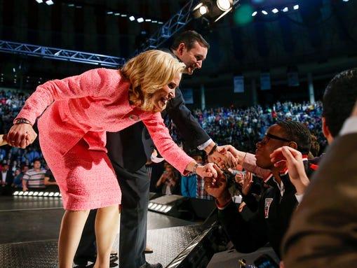 Sen. Ted Cruz, R-Texas, and his wife, Heidi, shake