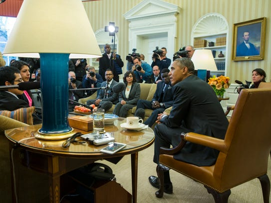 President Obama meets with a group in the Oval Office