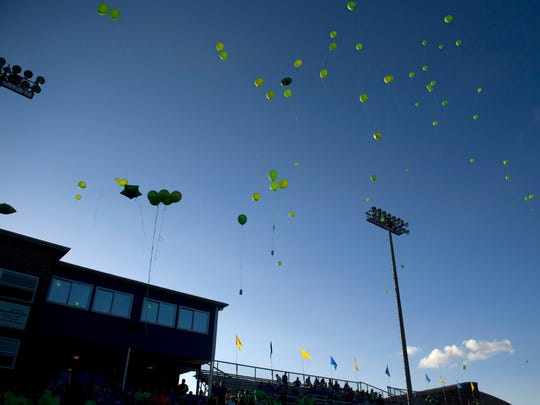 Ballons float over the at John Lidy Field stadium at Castle High School during the Give Back Game Friday night.