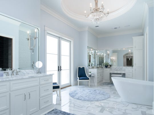 The master bath is a soothing spa-like retreat.
