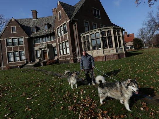 November 2017: Abe Rubinfeld walks his dogs past his