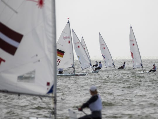 Sailors prepare for the first day of the Youth World Sailing Championships in Corpus Christi on Monday, July 16, 2018.