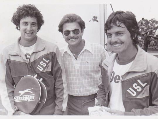 Former UL tennis coach Jerry Simmons, center, - shown