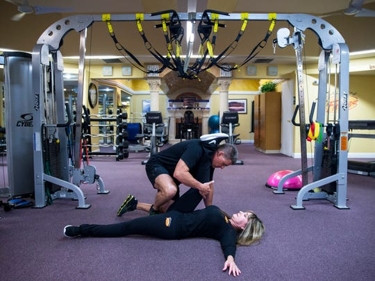 Exercise 5: Assisted hamstring stretch Have one partner lie on his or her back, with an ankle propped on the shoulders of a partner kneeling in front. The second person should slowly begin to stand up, stretching the hamstring of the first. Repeat the stretch with the other leg.