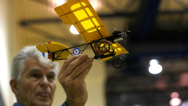 Roy Stoddard launches his remote controlled airplane last Sunday at Jerry A. Conner Fieldhouse in Farmington.