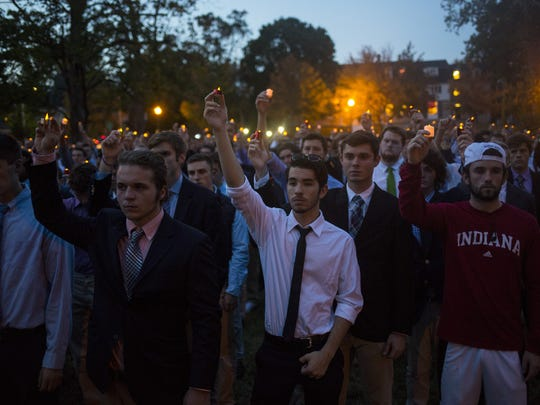 Mourners held aloft candles during a vigil for Joseph Smedley II and Yaolin Wang on Wednesday, Oct. 7, 2015, at Dunn Meadow Park on the Indiana University campus in Bloomington. Smedley's body was found Friday, Oct. 2, 2015, in Griffy Reservoir, and Wang was found stabbed to death in her off-campus apartment on Sept. 30, 2015.