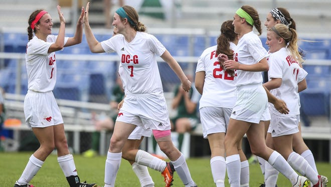 Dallas Center-Grimes'(7)Allison O'Brien celebrates her first half goal against Pella during their Class 2A first round game at the Iowa Girl's High School State Soccer Championships at Cownie Sports Complex Thursdasy June 11, 2015, in Des Moines, Iowa.