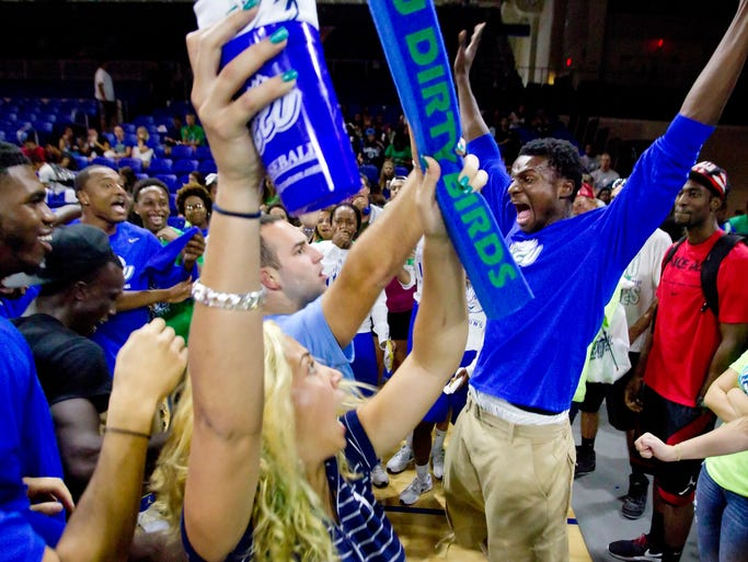"FGCU men's basketball player Marc-Eddy Norelia, right, ""dougies"" with Micheal Urban, center, at the 5th annual ""Eagle Revolution"" pep rally, held at FGCU Monday, August 18."