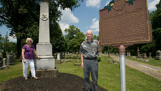 Karen and Jim Perone of Alliance stand next to a monument and historical marker in Alliance City Cemetery that commemorate the Sultana Tragedy.