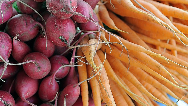 Fresh radishes and carrots were just some of the fresh produce available at a recent local market.