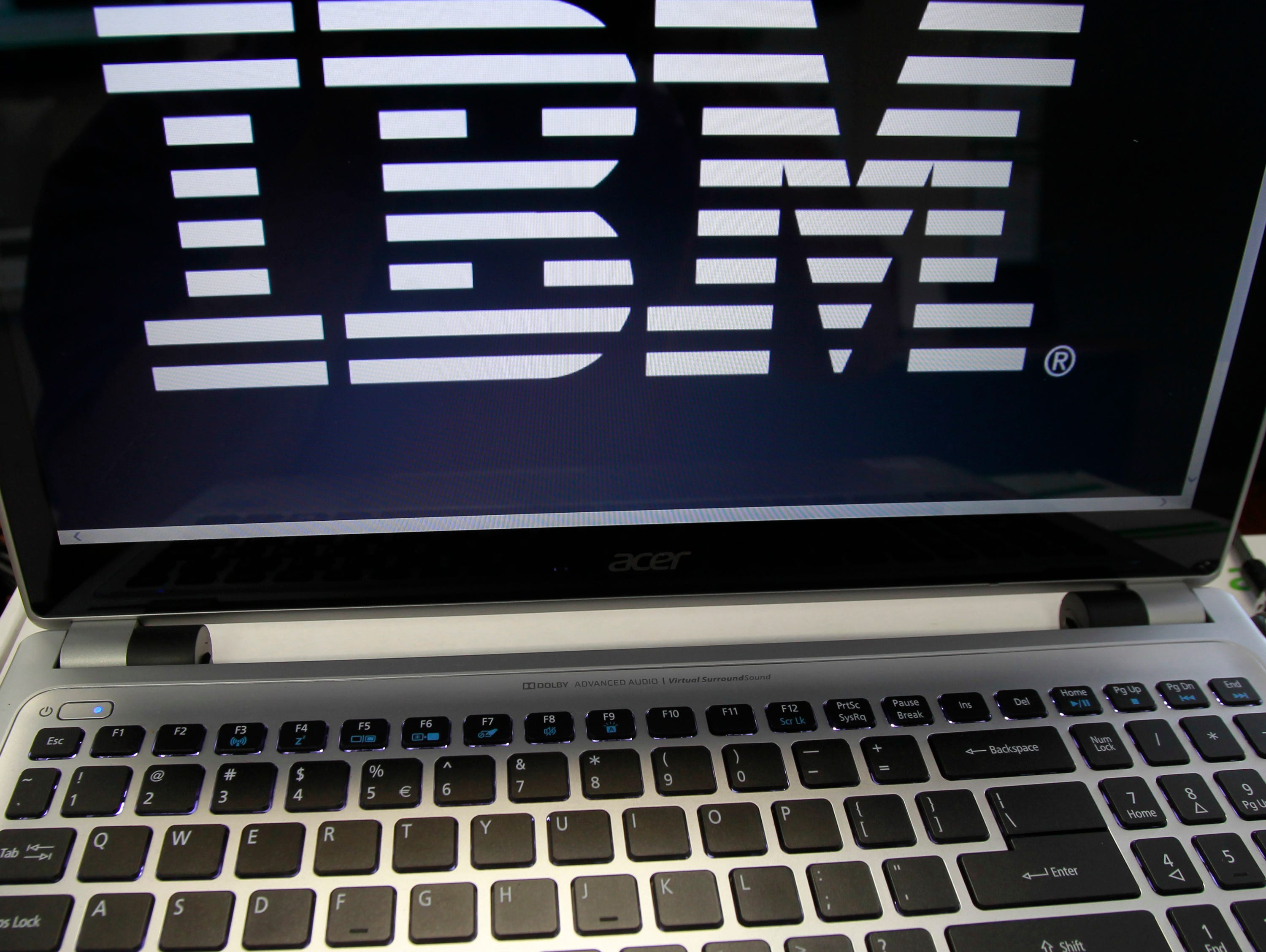 The IBM logo is displayed on a computer.