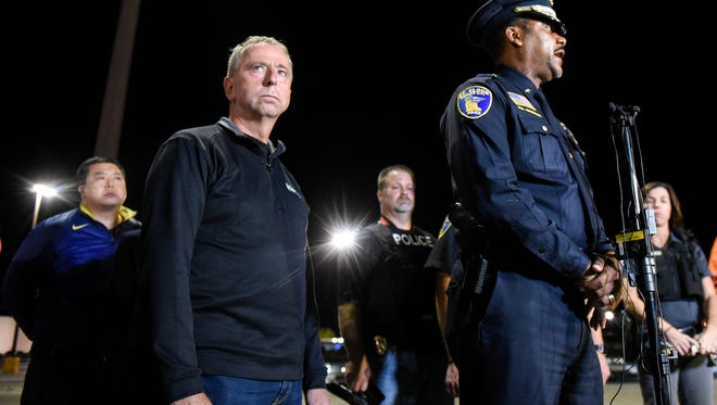 St. Cloud mayor Dave Kleis and police chief Blair Anderson conduct a press conference early Sunday morning from a parking lot near Crossroads Center.