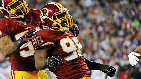 Linebacker Brian Orakpo celebrates a sack with the