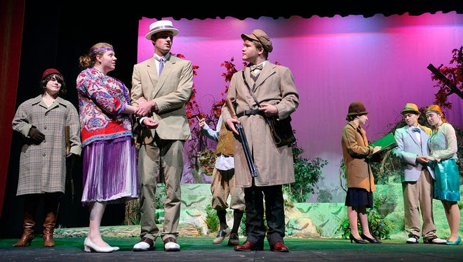 """The cast of the St. Cloud Tech production of """"A Midsummer Night's Dream"""" runs through a dress rehearsal Tuesday, Nov. 10. The play takes a modern approach to the classic work by William Shakespeare."""