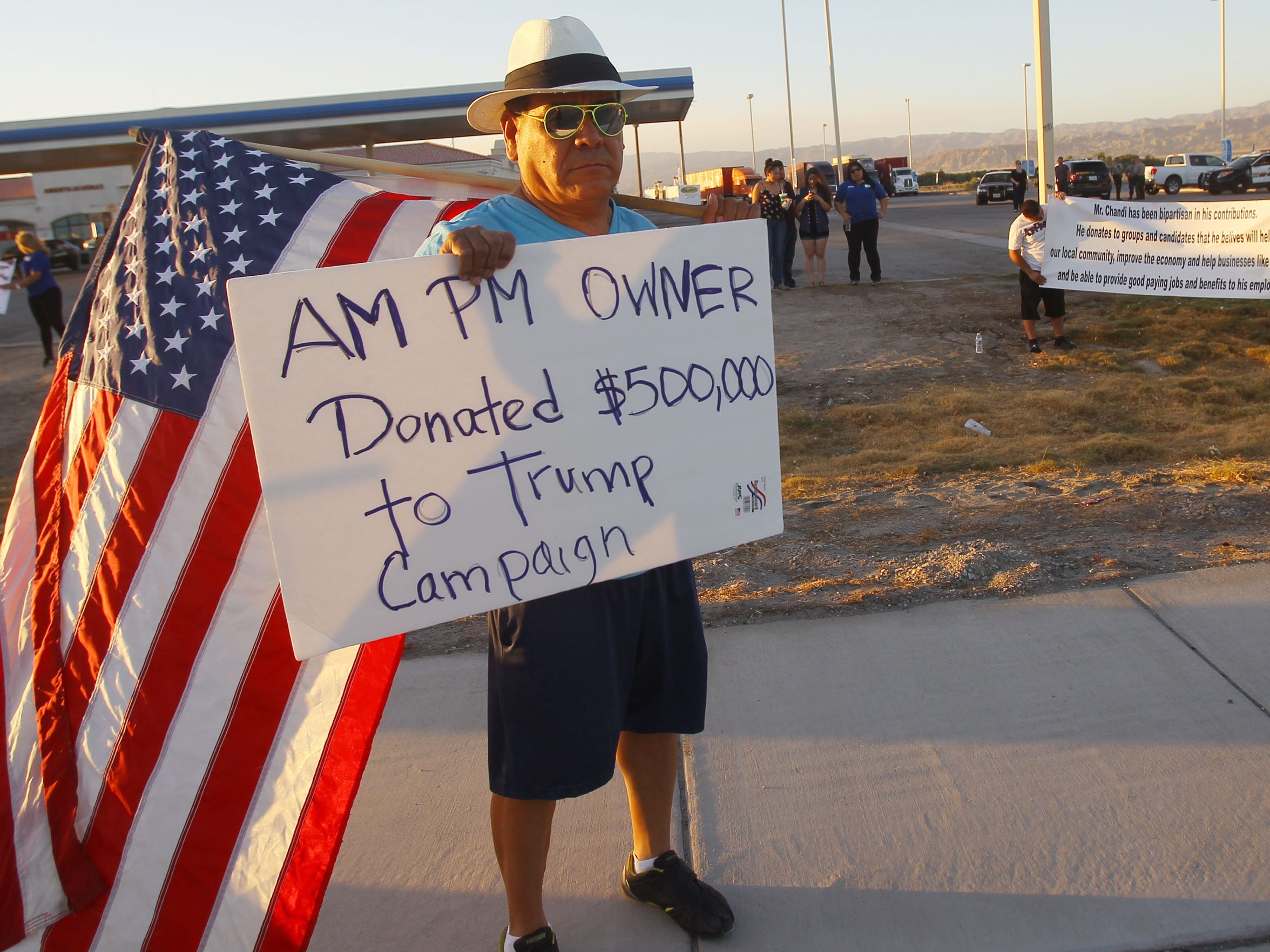 Residents of the Coachella Valley protest outside an