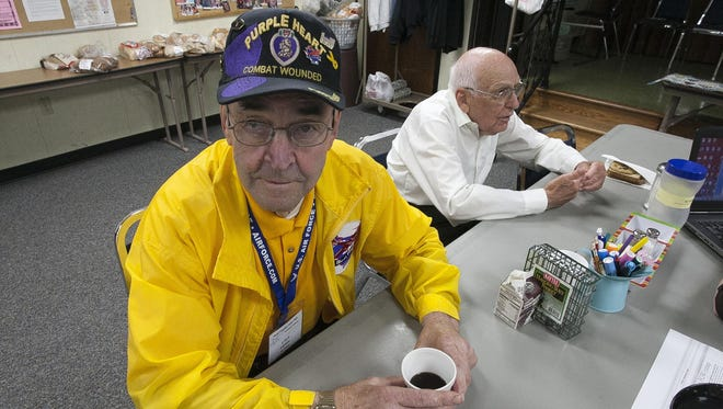Lloyd Larsen, left, and Edgar Kuhlow talk about their experiences as POWs Wednesday during a conversation at the Sheboygan Falls Aging and Disability Resource Center.