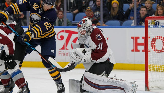 Buffalo Sabres Marcus Foligno (82) is stopped by Colorado Avalanche goalie Calvin Pickard (31) during the first period of an NHL hockey game, Thursday, Feb. 16, 2017, in Buffalo, N.Y. (AP Photo/Jeffrey T. Barnes)
