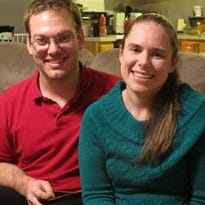 In this Tuesday, Nov. 25, 2014, photo, Alyssa Riggan, who was the first in the United States to successfully receive a liver from a living donor 25 years ago, poses with her husband, Benjamin, in their home in Severn, Md. As Riggan marks the 25th anniversary of her successful surgery on Thursday, she says its success has enabled her to live a normal life almost completely untouched by what was an often-fatal disorder. Riggan was 21 months old when her mother, Teri Smith, donated more than a third of her liver to save her daughter from a disorder called biliary atresia.