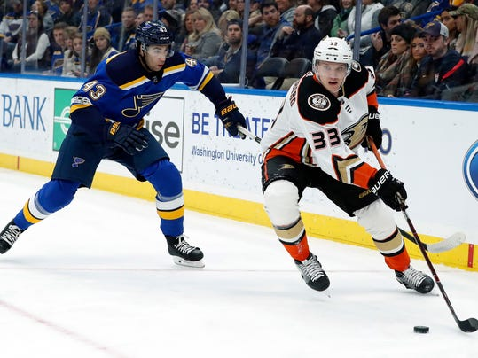 Anaheim Ducks' Jakob Silfverberg, of Sweden, controls the puck as St. Louis Blues' Jordan Schmaltz (43) defends during the first period of an NHL hockey game Thursday, Dec. 14, 2017, in St. Louis. (AP Photo/Jeff Roberson)