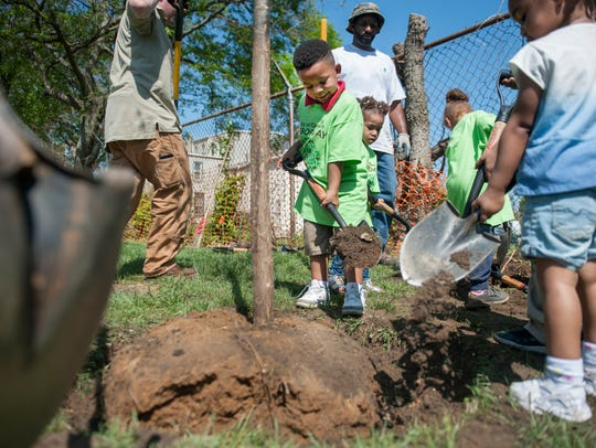 Students from Camden Day Nursery School assist in the