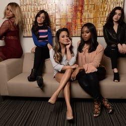 """Fifth Harmony have the poses down for our USA TODAY shoot: (L-R)  Dinah Jane, Camila Cabello, Ally Brooke, Normani Kordei and Lauren Jauregui. The group has a hit single and video """"Working from Home"""" and an upcoming album release """"7/27"""". Photo by Robert Hanashiro, USA TODAY Staff    -- Video and photo shoot of the vocal group Fifth Harmony. They have a hit single and music video out 'Working from Home'. Portrait shoot of the group; photos and video of the group teach dance moves to USAT's Carly Mallenbaum.--     ORG XMIT:  RH 134835 Fifth Harmony da 04/28/2016 [Via MerlinFTP Drop]"""