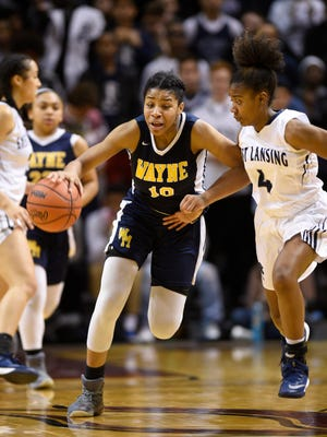 Wayne Memorial senior guard Jeanae Terry (with ball) has signed with Illinois and is ranked one of the top girls basketball players in the state.