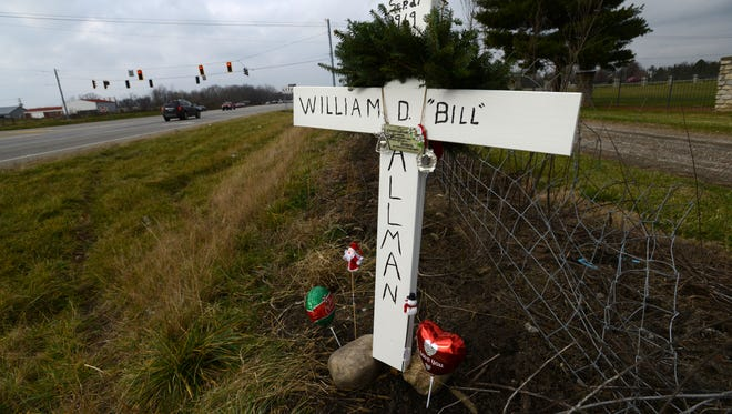 A cross commemorates the place where Bill Allman was struck by a vehicle on the side of U.S. 33 near Pickerington Road in Violet Township. Allman died two days after the crash. Fairfield County Sheriff's Deputy Lyle Campbell was hit by the same vehicle.