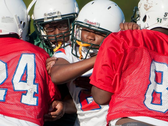 Central Hayneville High School player Swanique Gordon practices with teammates at the school near Hayneville, Ala., on Monday October 3, 2016. Gordon, a girl, is a starting linebacker with the team.