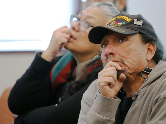 Selfa Chew and Michael Patino listen as District 5 city Rep. Dr. Michiel Noe once again places the Duranguito neighborhood as one of the sites for consideration for the proposed Downtown arena Tuesday morning during discussion at the weekly City Council meeting.