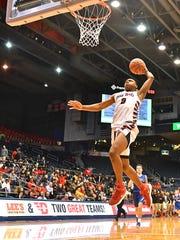 Hughes' Shawn Hawkins with a break away slam dunk in