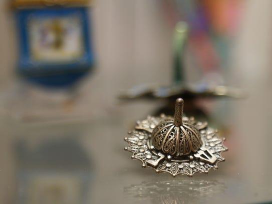 A dreidel on display at Temple Concord's Hanukkah House